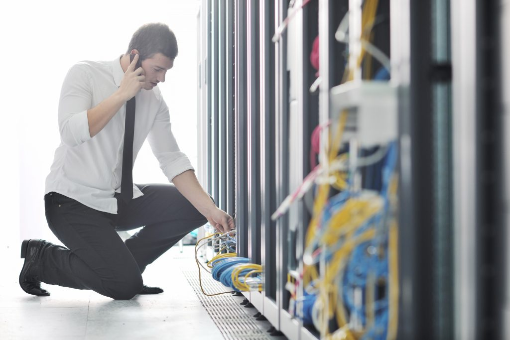 it engineer on phone 1024x683 - 10 Reasons to Consider Managed IT Services